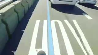 Dangerous motorcycle near-miss on highway