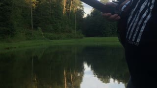Man Catches Fish with A Banjo