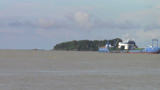 Ship passing an island at Songkhla Province, Thailand