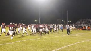 Football brawl: Players fight after a team flew a 'back the blue' flag