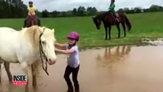 Watch Pony Dunk Little Girl Rider Into Mud and Roll Around