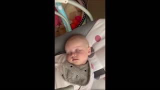 Sleeping baby in funny position