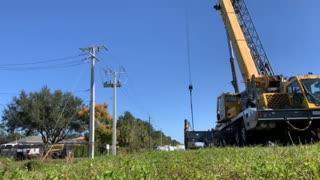 Apprentice setting 50' power pole