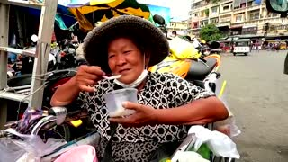 Meals on wheels for residents in virus-hit Cambodia