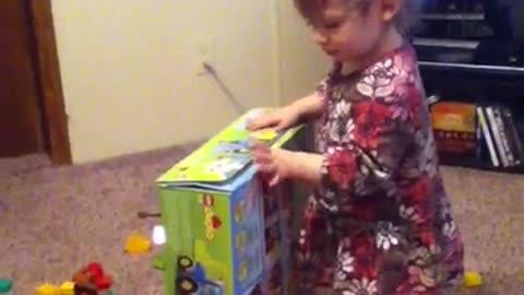 Teddy helps Emma put away toys