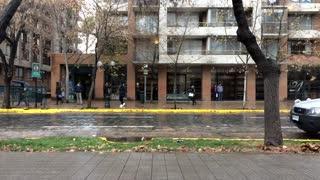 People Walking On Streets On Rainy Weather