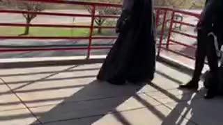 Man dressed as batman looking over city