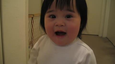 "Adorable Asian Girl Trying to Saying ""Frog"""