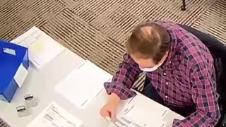 PA Poll Worker fills out ballots