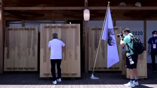 Bach visits Olympic Village, signs Truce Mural