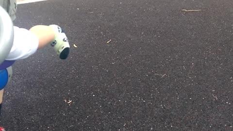 Little girl enjoys playtime at the park