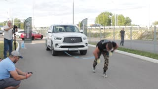 Guy Pulls Car While Doing Handstand