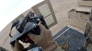 Military soldier having fun with Mini-Gun