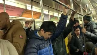 Guys sing and clap we will rock you by queen on subway train