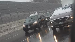 Woman Drives with Snow Completely Covering Windshield