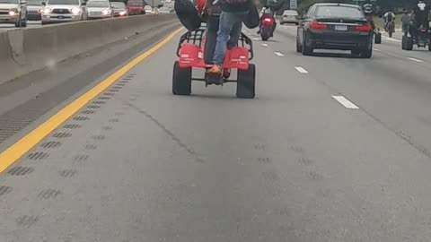 Woman Gets Mobbed By A Bunch of Stunt Riders On the Freeway
