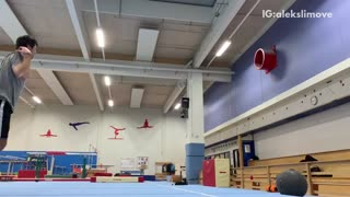 Guy does flips on gymnastics tumbling mat, falls, and lands on shoulder