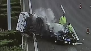 Traffic Cop At Accident Site Dodges Crashing Car
