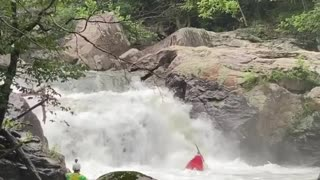 Kayaker performs complete flip while going over waterfall edge