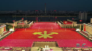 North Korea unveils new weapons at military parade