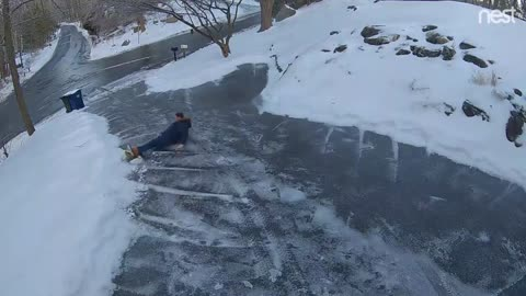 Man Slips Down Long Driveway Trying to Use Salt