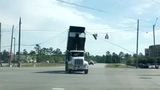 Raised Truck-Bed Takes out Traffic Lights