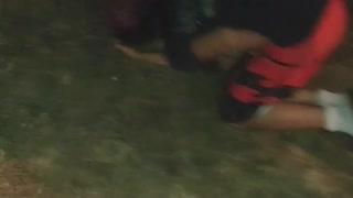 Girl green sweater kicks guy red shorts