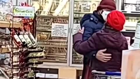 Elderly couple caught slow dancing at the grocery store