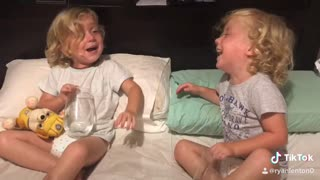 Young Twins Argue Over Who Spilled the Water
