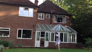 Boy Smashes a Window With a Baseball