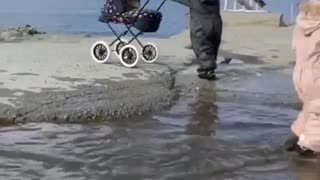 Toddler Takes a Tumble into Puddle
