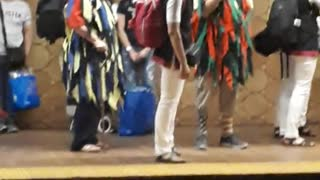 People playing flute and drums on subway station
