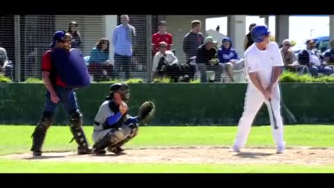 Baseball player face plants on way to first base