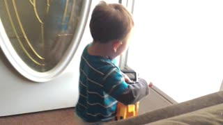 Toddler hilariously makes chainsaw noises with his chainsaw toy