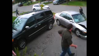 Distracted driver crashes into parked car