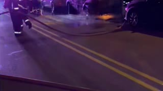 Fire Department Hoses Down Flaming Car
