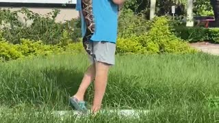 Man Taking a Snake for a Stroll