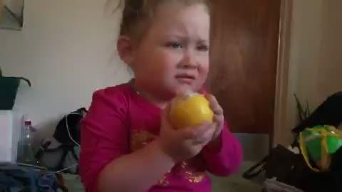 Toddler tries a lemon