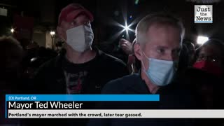 Portland Mayor marches with crowd and is later tear gassed