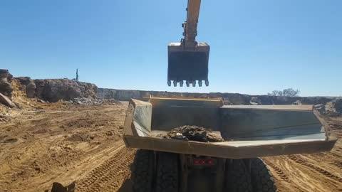Digging some rock with an excavator