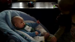 Toddler Bodhi sooths his new baby brother