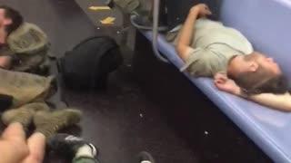 Several homeless people asleep on subway
