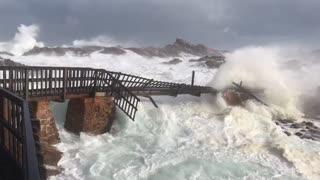 Bridge Broken Apart by Huge Storm
