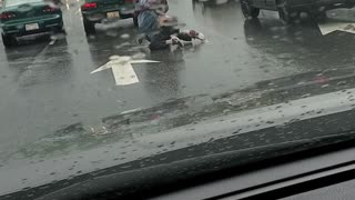 Brawl in the Rain at an Intersection