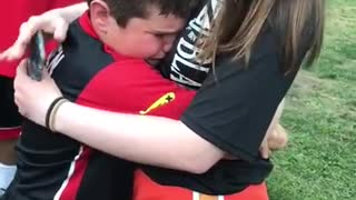 Army sister surprises little brother at ballgame