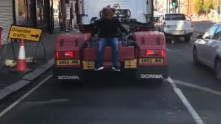 Man Wearing Bear Mask Catches a Ride
