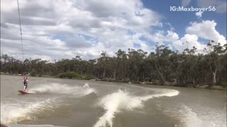 Woman does front flip trick on wakeboard and goes under water