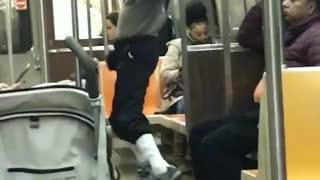 Man sunglasses grey sweater workout jump dance subway train