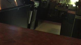 Saloon Owner Puts Hands Around Employee's Neck