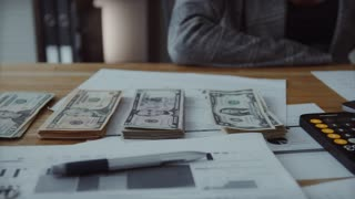 Commercial photography, close-up shot of calculating money, 13 seconds